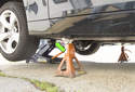 Jacking front of vehicle: When using a hydraulic floor jack to lift the front of the vehicle, place the hydraulic floor jack under the square subframe support (green arrow).