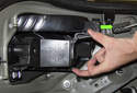 Squeeze the release tabs on the socket assembly and pull the socket assembly out of the taillight.