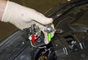 High beam bulb: Pull the headlight bulb (green arrow) out of its socket (red arrow) and replace it with a new bulb.