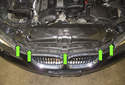 Headlight assembly: Then, remove the five T30 Torx bumper cover fasteners (green arrows).