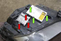 Headlight assembly: Flip the headlight over to service the control modules.