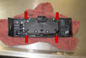 Headlight Switch: Separate the headlight switch from the trim piece by removing the four T10 Torx screws (red arrows).