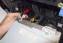 Radio: Remove the control cable (red arrow) from the radio by pulling it straight out of the radio.