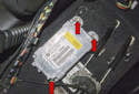 Airbag control module: Using a T30 Torx driver, remove the three airbag control module fasteners (red arrows).