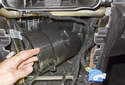 Remove the blower motor housing cover, feeding the left side out first.