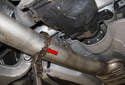 Use a pipe cutter (red arrow) to cut the exhaust pipe.
