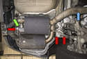 If your vehicle has a tailpipe flap, disconnect the vacuum hose (green arrow) to the tailpipe flap.