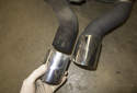 Pull the chrome exhaust tips off the old muffler and transfer them to the new one.