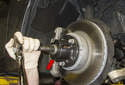 If the axle does not slide out of the wheel bearing easily, tap it out using a brass punch and a soft-faced hammer.