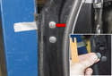 Using a plastic prying tool, gently lever out the upper rubber plug (red arrow).