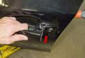 Then pull the door handle straight out of the door to detach the door lock cylinder side of the handle.