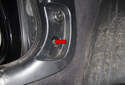 Then remove the kick panel Phillips head screw (red arrow).