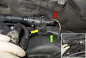 Rear intake charge air duct: Working at the rear of the engine at the cylinder head, detach the breather hose from the duct (green arrow).