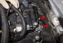 Rear intake charge air duct: Then, working at the rear of the cylinder head, remove the two T30 Torx duct fasteners (red arrows).