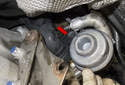 Rear intake charge air duct: Pull the duct away from the turbocharger in the direction of the red arrow.