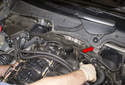 Rear intake charge air duct: Remove the air duct from behind the engine in the direction of the red arrow.