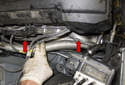 Turbocharger outlet pipes: With the reservoirs removed, you can now see the turbocharger outlet pipes (red arrows).