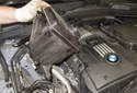 Drain the cooling system and remove the coolant reservoir.