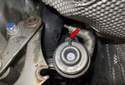 Next, remove the 10mm nut from the duct (red arrow).