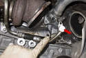 Then pull the line (red arrow) out of the flange at the engine block.