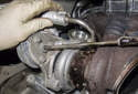 Next, remove the upper coolant line from the turbocharger.