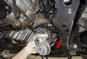 Remove the turbocharger from the engine in the direction of the red arrow.