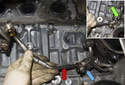 Remove the T45 Torx oil line fastener (blue arrow).