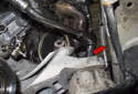 Remove the 16mm engine mount nut (red arrow).