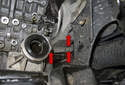 Then remove the three E14 engine mount fasteners (red arrows).