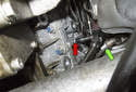 Working below the turbocharger, next to the oil drain (green arrow), remove the E8 heat shield fastener (red arrow).