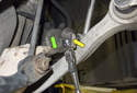 To remove the height sensor, remove the 10mm boss (green arrow) while loosening the 10mm nut (yellow arrow).