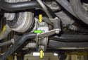 Front sway bar: Working at the right side sway bar bushing, remove the 10mm power steering line support bracket fastener (green arrow).