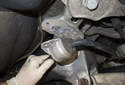 Rear sway bar links: Pull the stabilizer bar down away from the subframe.