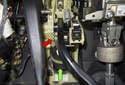 Working next to the brake pedal (green arrow) underneath the dashboard, remove the brake pedal shaft clip (red arrow).