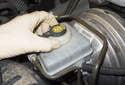 Remove the brake fluid reservoir cap.