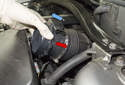 Remove the sensor from the intake air housing lid by pushing it toward intake air duct (red arrow), then pull it up and remove from engine (blue arrow).