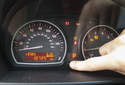 THIRD: Skip test function by pressing the Odometer / Trip Reset button until the display reads OIL SERVICE or INSPECTION.