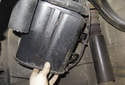 Remove the canister fastener side first and remove from the vehicle.