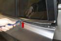 Lever off door window seal straight up (red arrow).