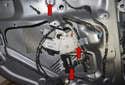 Remove the three 10mm window regulator fasteners (red arrows).