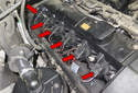 BMW X3 models equipped with an M54 6-cylinder engine utilize an individual ignition coil for each spark plug, referred to as coil over plug (red arrows).