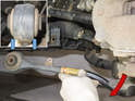 Lever bushing out of subframe using a prybar.