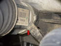 Next, use a long prybar (yellow arrow) to lever the axle (red arrow) out of the front differential.