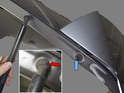 Tailgate Support Struts: Working at the top of the support strut, lever the bottom retaining clip to the end to disengage it (red arrow).