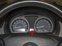 The instrument cluster (red arrow) on BMW X3 models incorporates multiple information gauges that display engine operation information.