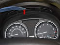 Next, pull the top of the instrument cluster straight out of the dashboard.
