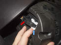 Then working at the back of the instrument cluster, detach the wiring harness from the back of the cluster.