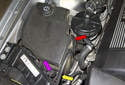 The windshield washer fluid reservoir is located on the right side of the engine compartment.