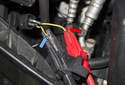 Connect a test light or DVOM across the washer pump electrical connector terminals.