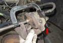 Press piston back into caliper using a brake caliper piston tool or a C-clamp.